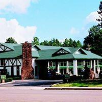 Woodland Inn & Suites logo