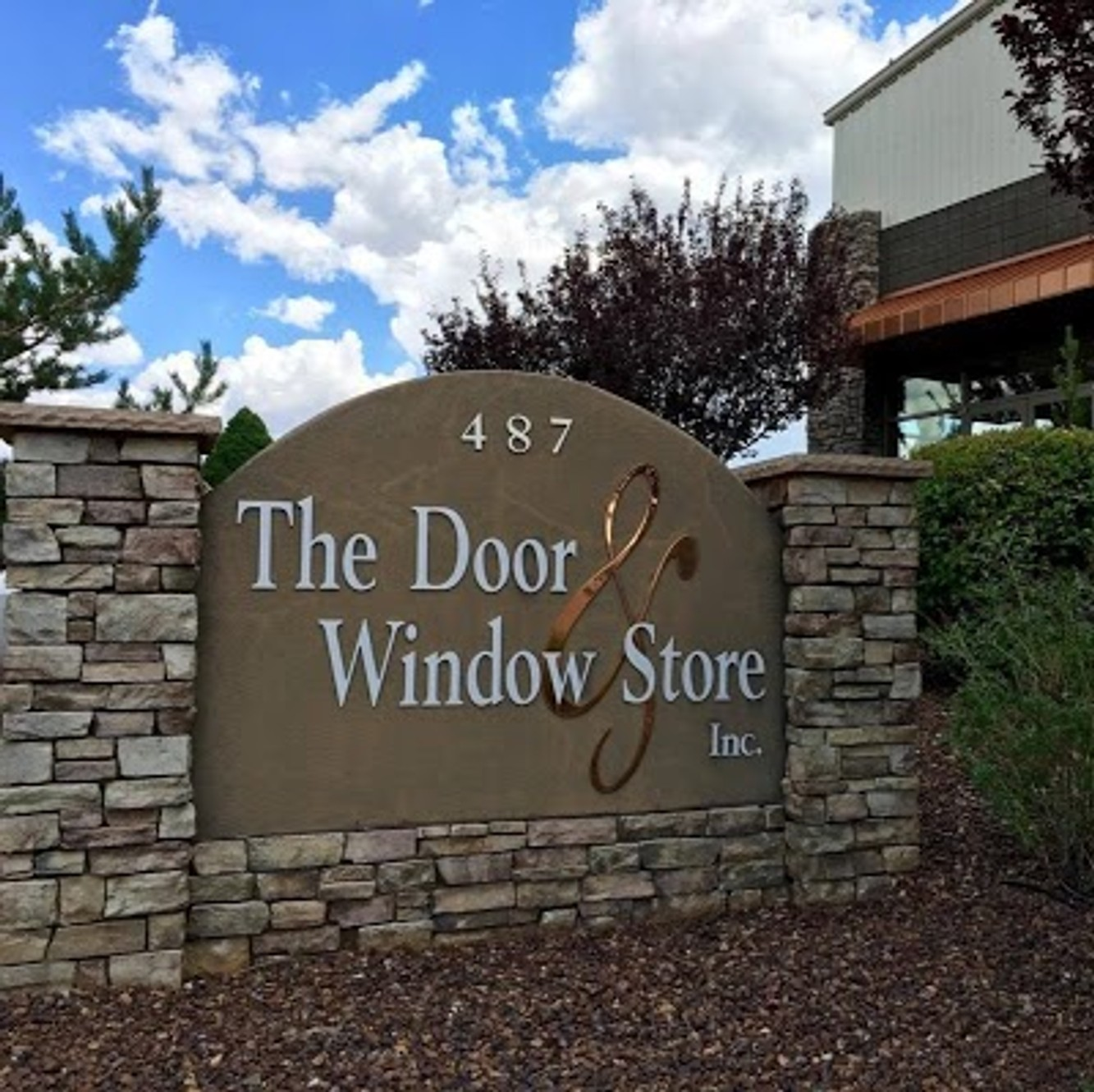 Door And Window Store The logo