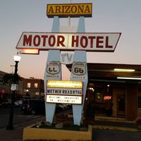 Arizona 9 Motor Hotel logo